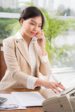 Beautiful Asian secretary Royalty Free Stock Photo