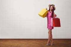 Beautiful asian shopping woman happy smiling wearing hat stock photography