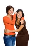 Beautiful Asian sisters having fun isolated Stock Photo