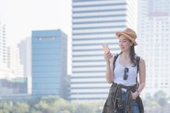 Beautiful asian solo tourist woman smiling and looking at mobile phone for searching tourists sightseeing spot royalty free stock photos