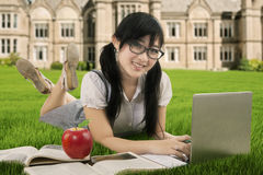 Beautiful Asian student learns at field Stock Photo