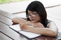 Beautiful Asian student woman sleep. Royalty Free Stock Images