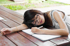 Beautiful Asian student woman sleep. Royalty Free Stock Photography