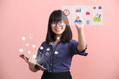Beautiful Asian teen gesture virtual monitor Stock Photo