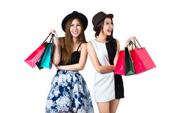 Beautiful asian teen girls carrying shopping bags. Isolated over white royalty free stock images