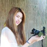 Beautiful Asian teenage girl enjoying selfie Stock Image