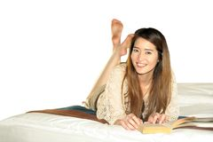 Beautiful Asian teenage smile pocketbook Royalty Free Stock Images