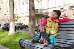 Beautiful asian tourist sitting on a bench Stock Photo