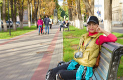 Beautiful asian tourist sitting on a bench Royalty Free Stock Images