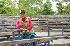 Beautiful asian tourist woman sitting on a bench Stock Photo