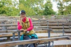 Beautiful asian tourist woman sitting on a bench Stock Photo