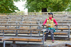 Beautiful asian tourist woman sitting on a bench Stock Photography
