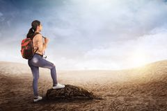 Beautiful asian traveler woman with backpack. On the mountain Stock Photo