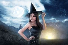 Beautiful asian witch woman with hat stock images
