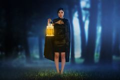 Beautiful asian witch woman holding the glowing lantern stock photos