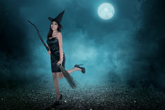 Beautiful asian witch woman ready to fly Royalty Free Stock Images