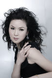 Beautiful Asian Woman. A beautiful, young Chinese woman in a high fashion pose Stock Images