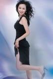 Beautiful Asian Woman. A beautiful, young Asian woman in a high fashion pose Stock Image