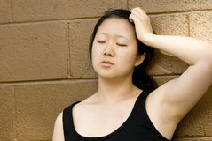 Beautiful Asian woman, athlete, frustrated Royalty Free Stock Photo