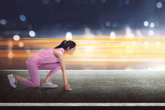 Beautiful asian woman athlete in start position ready to running Royalty Free Stock Image