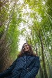 A woman with bamboo forest in background stock image