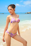 Beautiful asian woman on a beach Royalty Free Stock Photos