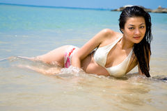 Beautiful asian woman at the beach Stock Images