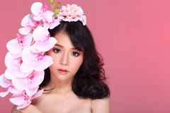 Beautiful Asian Woman black hair with flora crowd, holding bouquet artificial rose over chest stock images
