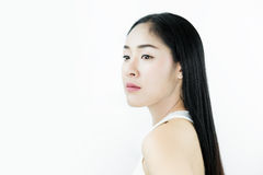 Beautiful Asian Woman with Black Hair, with Healthy Skin, on white background Royalty Free Stock Photo