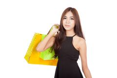 Beautiful Asian woman in black hold shopping bags Royalty Free Stock Photography