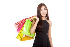 Beautiful Asian woman in black hold shopping bags Royalty Free Stock Photos