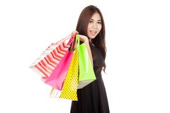 Beautiful Asian woman in black hold shopping bags Royalty Free Stock Images