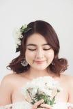Beautiful asian woman bride on grey background. Closeup portrait Stock Photo