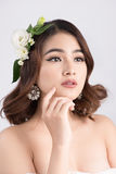 Beautiful asian woman bride on grey background. Closeup portrait. S with a professional makeup Royalty Free Stock Images