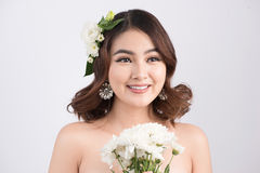 Beautiful asian woman bride on grey background. Closeup portrait. S with a professional makeup Royalty Free Stock Photography