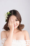 Beautiful asian woman bride on grey background. Closeup portrait Stock Photo