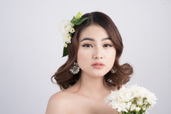 Beautiful asian woman bride on grey background. Closeup portrait Royalty Free Stock Photography