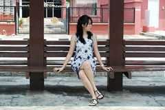 Beautiful Asian Woman at Bus Stop Royalty Free Stock Photo