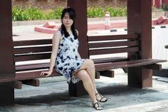 Beautiful Asian Woman at Bus Stop Royalty Free Stock Image