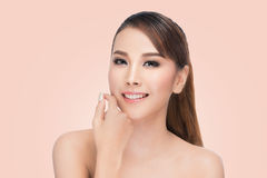 Beautiful Asian woman cares for the skin face Beautiful Spa Stock Image