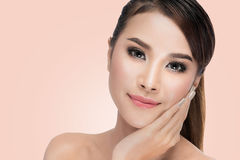 Beautiful Asian woman cares for the skin face Beautiful Spa Royalty Free Stock Images