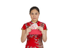 Beautiful asian woman with chinese traditional dress,  red packe Stock Image