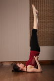 Beautiful Asian woman doing floor exercise stock image