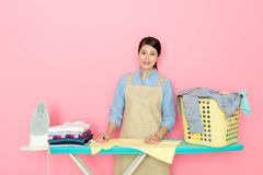 Beautiful Asian woman doing the ironing Royalty Free Stock Photography