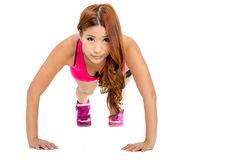 Beautiful Asian woman doing pushups Royalty Free Stock Photo