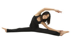 Beautiful Asian woman doing yoga. Beautiful Asian woman exercising and stretching on the floor Royalty Free Stock Photo