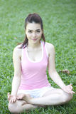 Beautiful Asian woman doing yoga Royalty Free Stock Image
