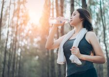 Beautiful asian woman drinking water bottle stock photo