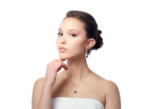 Beautiful asian woman with earring and pendant Royalty Free Stock Image