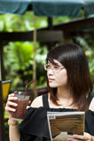 Beautiful Asian woman enjoy iced tea. Stock Photos